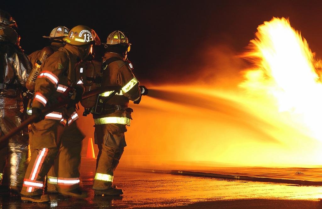 Civilian firefighters spray a simulated pit fire during a training session at the 167th Air Wing (AW), West Virginia Air National Guard (WVANG), Martinsburg, West Virginia (WV) fire training area. The Airport Rescue Firefighting training is a West Virginia University (WVU) program designed to provide required Federal Aviation Administration (FAA) annual training