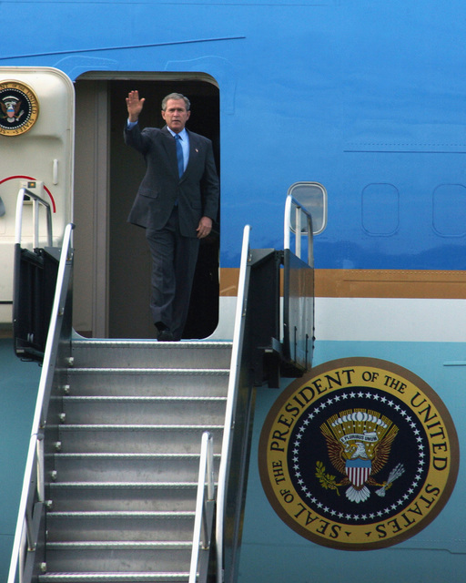 "President George W. Bush emerges from Air Force One after landing at Toledo Express Airport (TOL), for his tour of Ohio (OH). Bush is conducting his ""Industrial Midwest"" Campaign in support of the upcoming elections"