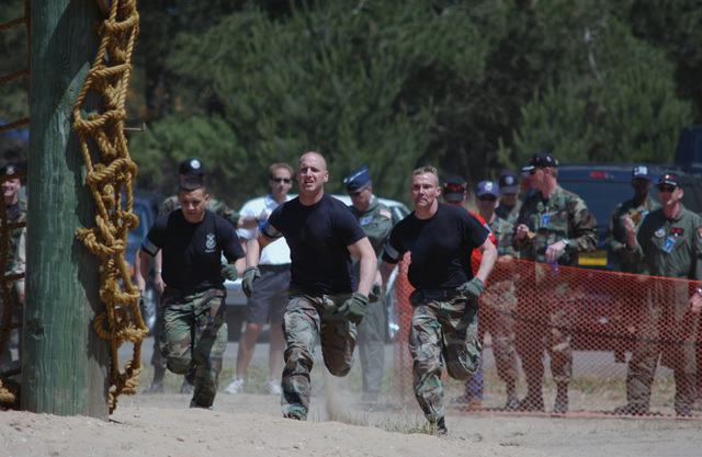 US Air Force (USAF) team members of the Security Police Forces (SPF) from the 90th Space Wing (SW), F.E. Warren Air Force Base (AFB), Wyoming (WY), run towards the first event in the obstacle course during Guardian Challenge. Guardian Challenge, the world's premier space and missile competition, is a four-day event hosted annually at Vandenberg AFB, California (CA)