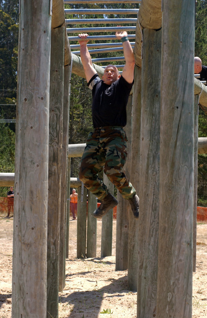 """US Air Force (USAF) Technical Sergeant (TSGT) Sidney Birch from the 310th Space Group (SG), Schriever Air Force Base (AFB), Colorado (CO), completes """"Tarzan,"""" an obstacle in the obstacle course portion of Guardian Challenge. Guardian Challenge, the world's premier space and missile competition and a four-day event hosted annually at Vandenberg Air Force Base (AFB), California (CA)"""