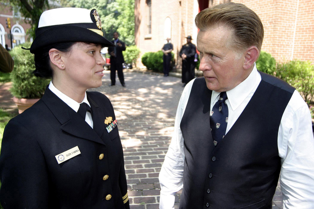 """US Navy (USN) Lieutenant (LT) Eileen D'Andrea, (left), and Actor, Martin Sheen, discuss the set-up of a scene for the television show, """"The West Wing,"""" being filmed inside the garden of the historic St. Anne's Church, located in Annapolis, Maryland (MD)"""