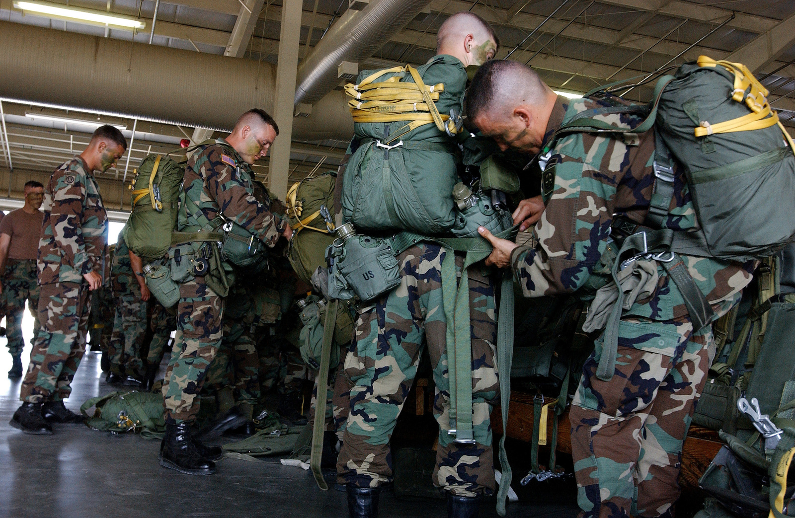 US Army (USA) Jumpmasters check their paratroopers chutes prior to an airdrop during exercise Large Package Week at Pope Air Force Base (AFB), North Carolina (NC). Large Package Week is a joint US Army and US Air Force airdrop, designed to enhance service cohesiveness