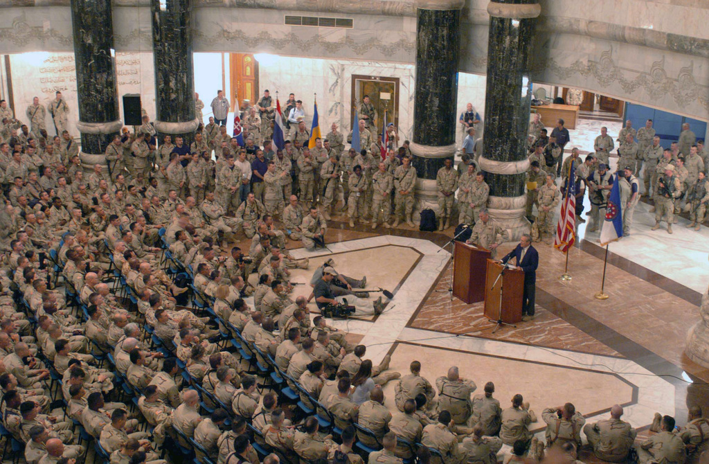 At a palatial town hall meeting, Secretary of Defense Donald Rumsfeld and U.S. Air Force Chairman of the Joint CHIEF of STAFF GEN. Richard Myers address US Military personnel in the Al-Faq Palace at Camp Victory, Baghdad, Iraq during Operation Iraqi Freedom. (DoD photo by SGT. Donald Bohanner) (Released)