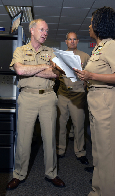 US Navy (USN) CHIEF of Naval Personnel, Vice Admiral (VADM) Gerald L. Hoewing (left), meets with CHIEF Navy Counselor (NCC) Robbie Bledsoe (right), Naval Recruiting Command Cyberspace Division, and Rear Admiral (RDML) Jeffrey L. Fowler, Commander Naval Recruiting Command (CNRC), during a visit to the Naval Recruiting Command, Naval Support Activity Mid-South, Millington, Tennessee. Cyberspace is responsible for using the Internet and World Wide Web (WWW) to expand the pool of potential recruits and providing pre-screened and pre-qualified leads to the officer and enlisted recruiting force