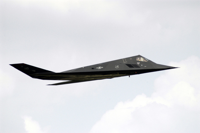 An US Air Force (USAF) F-117A Nighthawk stealth fighter aircraft assigned to the 49th Fighter Wing (FW), makes a low-level fly-by during the Joint Service Open House Celebration held at Andrews Air Force Base (AFB), Maryland (MD). The open house showcased civilian and military aircraft and provided many flight demonstrations and static displays
