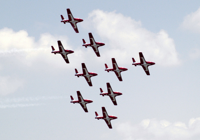 Nine Canadian Forces Air Command CT-114 Tutor basic pilot training aircraft assigned to the 431 Squadrons Aerial Demonstration Team Snowbirds perform a formation fly by the Joint Service Open House Celebration held on the flight line at Andrews Air Force Base (AFB), Maryland (MD). The open house showcased civilian and military aircraft and provided many flight demonstrations and static displays