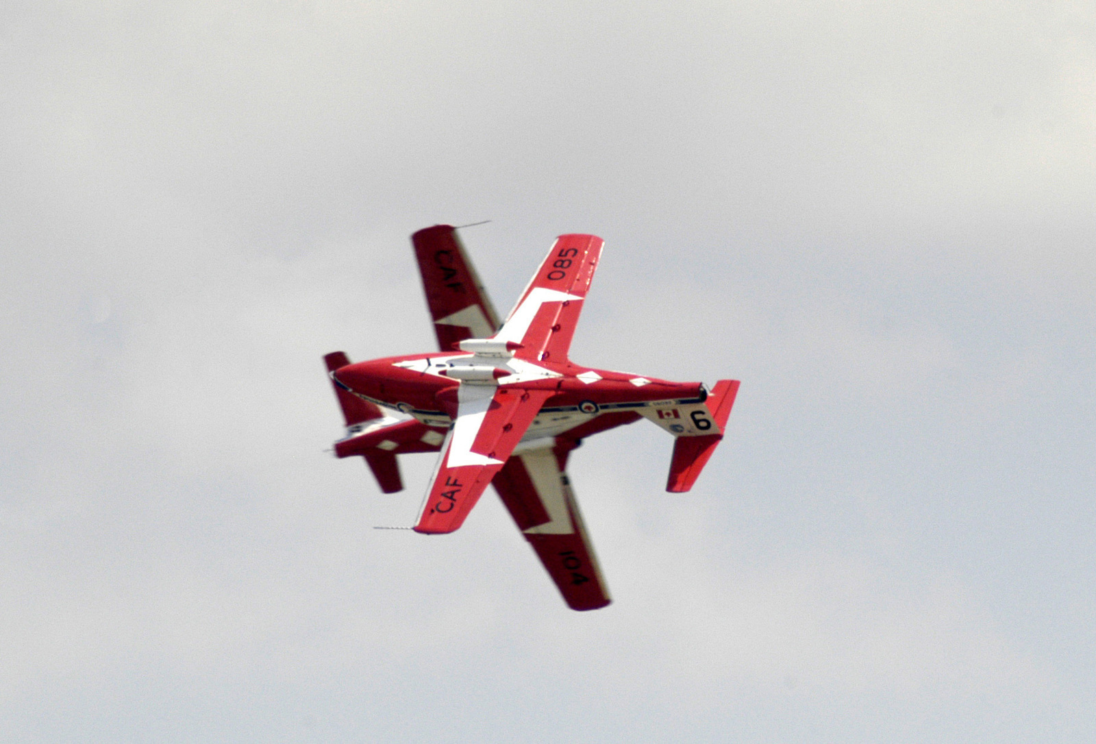 Two Canadian Forces Air Command CT-114 Tutor basic pilot training aircraft assigned to the 431 Squadrons Aerial Demonstration Team Snowbirds perform a crossing maneuver during the Joint Service Open House Celebration held on the flight line at Andrews Air Force Base (AFB), Maryland (MD). The open house showcased civilian and military aircraft and provided many flight demonstrations and static displays