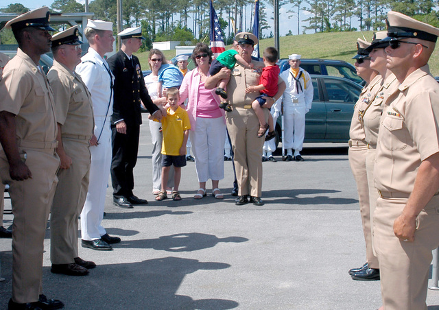 US Navy (USN) MASTER CHIEF PETTY Officer (MCPO) Steven E. Felter, stands with his family and requests permission to go ashore at the conclusion of his retirement ceremony. A MASTER CHIEF Engineman (ENCM), MCPO Felter is the most senior enlisted man in the Navy on the East Coast having served for thirty-three years