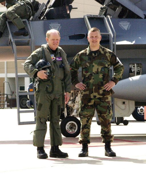 """US Air Force (USAF) Major General (MGEN) John Smith (left), Adjutant General (AG) for the state of Ohio's Army (OHARNG) and Air National Guard (OHANG), poses for a picture with his son Technical Sergeant (TSGT) Pete Smith, before his """"fini"""" or final flight with the 180th Fighter Wing (FW), Toledo, Ohio (OH)"""