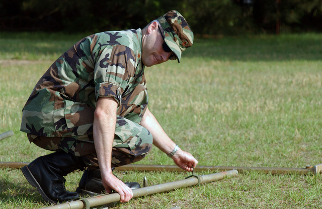 """Patterson, assigned to the 20th Fighter Wings Judge Advocate Generals (JAG) Office helps to prepare for field operations law training by setting up a """"temper"""" tent at Shaw Air Force Base, South Carolina (SC)"""