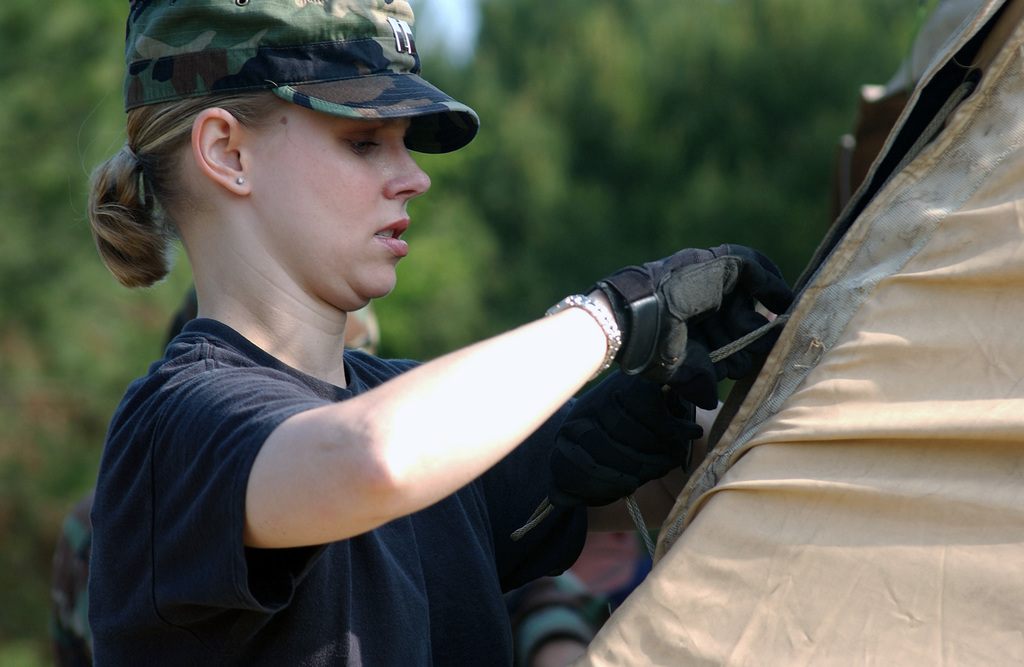 """US Air Force (USAF) Captain (CPT) Rebecca Tatum, CHIEF of Operations Law for the 20th Fighter Wing (FW) STAFF Judge Advocate (SJA) Office, Shaw Air Force Base (AFB), South Carolina (SC), prepares for field operations law training by setting up a """"temper"""" tent"""