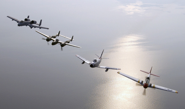 A US Air Force (USAF) A-10 Thunderbolt attack aircraft (left) piloted by Captain (CPT) Matt Kouchoukos, a vintage P-38 Lightning fighter aircraft (second left) piloted by Steve Hinton, an F-86 Sabre jet fighter piloted by Dale Snodgrass and a P-51 Mustang fighter aircraft piloted by Ed Shipley (right) participate in a Heritage Flight formation, showing four generations of Air Force Fighters. The Heritage Flight was part of the Airpower over Hampton Roads show at Langley Air Force Base (AFB), Virginia (VA)