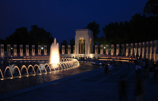 After dark, the illuminated fountains of the newly completed National World War II Memorial, in the Washington, District of Columbia, established by the American Battle Monuments Commission, honoring military veterans of World War II