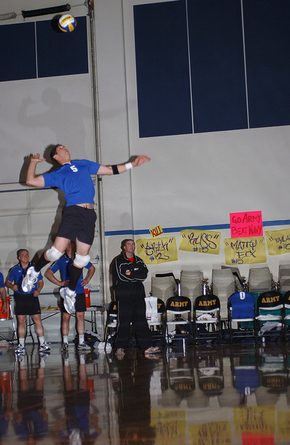 US Air Force (USAF) team middle hitter Kyle Klinger, from Hurlburt Field, Florida (FL), jump serves a ball over the net for a point. Finals were held at the 2004 Armed Forces Volleyball tournament held at Fort Lewis, Washington (WA)