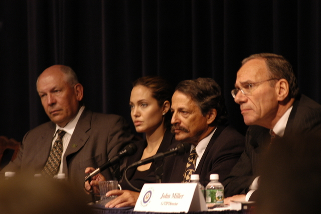 "[Assignment: 59-CF-DS-11872-04] Secretary's Open Forum session on the documentary film investigating Southeast Asian sex trafficking, ""Trading Women."" [Panel discussion in Loy Henderson Auditorium featured the film's narrator, actress Angelina Jolie; the film's writer-director, David Feingold; Under Secretary for Global Affairs Paula Dobriansky;  and Ambassador-at-Large and Director of State's Office to Monitor and Combat Trafficking in Persons, John Miller. Panelists were introduced by Open Forum Chairman William Keppler.] [Photographer: Ann Thomas--State] [59-CF-DS-11872-04_O_F_5_25_04_051.jpg]"