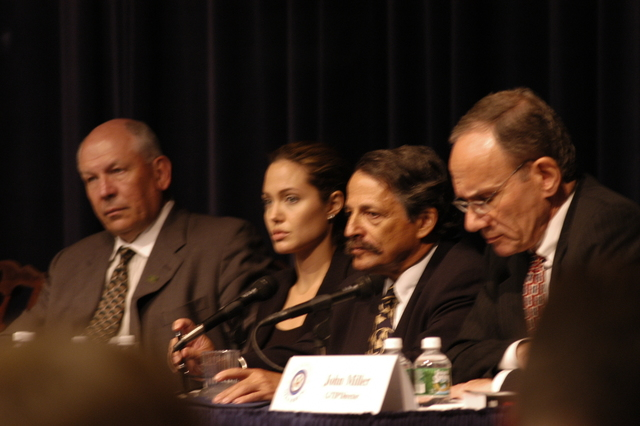 "[Assignment: 59-CF-DS-11872-04] Secretary's Open Forum session on the documentary film investigating Southeast Asian sex trafficking, ""Trading Women."" [Panel discussion in Loy Henderson Auditorium featured the film's narrator, actress Angelina Jolie; the film's writer-director, David Feingold; Under Secretary for Global Affairs Paula Dobriansky;  and Ambassador-at-Large and Director of State's Office to Monitor and Combat Trafficking in Persons, John Miller. Panelists were introduced by Open Forum Chairman William Keppler.] [Photographer: Ann Thomas--State] [59-CF-DS-11872-04_O_F_5_25_04_050.jpg]"