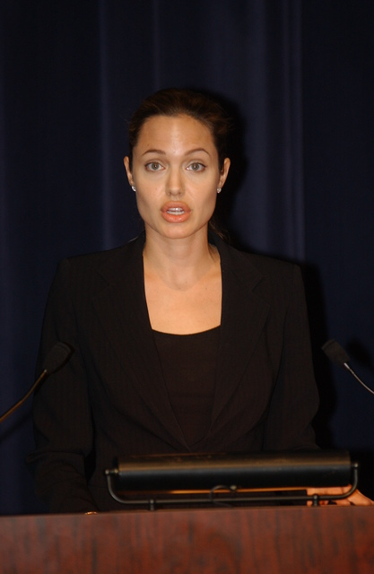 "[Assignment: 59-CF-DS-11872-04] Secretary's Open Forum session on the documentary film investigating Southeast Asian sex trafficking, ""Trading Women."" [Panel discussion in Loy Henderson Auditorium featured the film's narrator, actress Angelina Jolie; the film's writer-director, David Feingold; Under Secretary for Global Affairs Paula Dobriansky;  and Ambassador-at-Large and Director of State's Office to Monitor and Combat Trafficking in Persons, John Miller. Panelists were introduced by Open Forum Chairman William Keppler.] [Photographer: Ann Thomas--State] [59-CF-DS-11872-04_DSC_3090.JPG]"