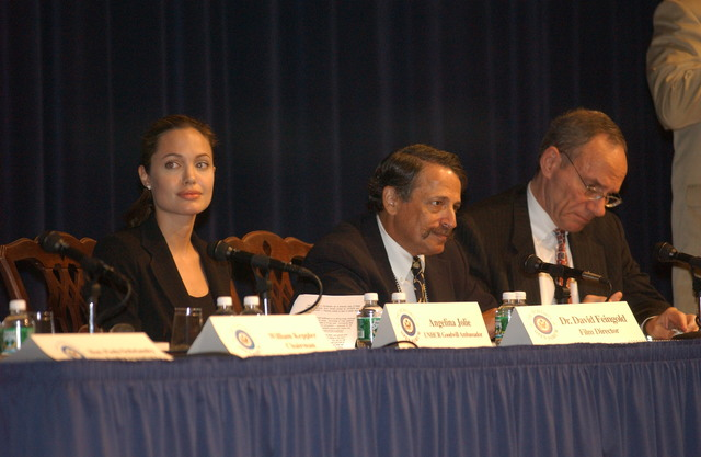 "[Assignment: 59-CF-DS-11872-04] Secretary's Open Forum session on the documentary film investigating Southeast Asian sex trafficking, ""Trading Women."" [Panel discussion in Loy Henderson Auditorium featured the film's narrator, actress Angelina Jolie; the film's writer-director, David Feingold; Under Secretary for Global Affairs Paula Dobriansky;  and Ambassador-at-Large and Director of State's Office to Monitor and Combat Trafficking in Persons, John Miller. Panelists were introduced by Open Forum Chairman William Keppler.] [Photographer: Ann Thomas--State] [59-CF-DS-11872-04_DSC_3002.JPG]"