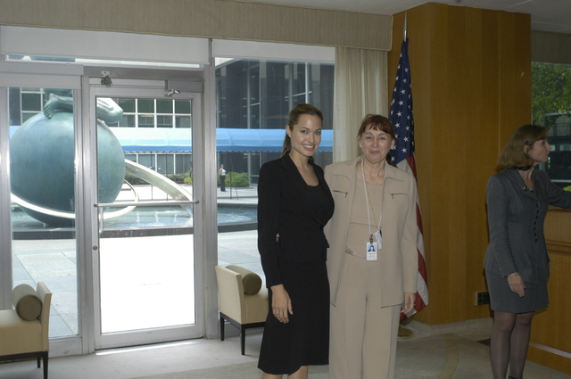 "[Assignment: 59-CF-DS-11872A-04] Reception at Harry S. Truman Building for actress Angelina Jolie, greeted by Department officials and staff [including Secretary Colin Powell, Under Secretary for Global Affairs Paula Dobriansky, and Secretary's Open Forum Chairman William Keppler. Jolie participated in Open Forum panel discussion of the documentary film that she narrated, ""Trading Women,"" an investigation of Southeast Asian sex trafficking.] [Photographer: Ann Thomas--State] [59-CF-DS-11872A-04_DSC_0024.JPG]"