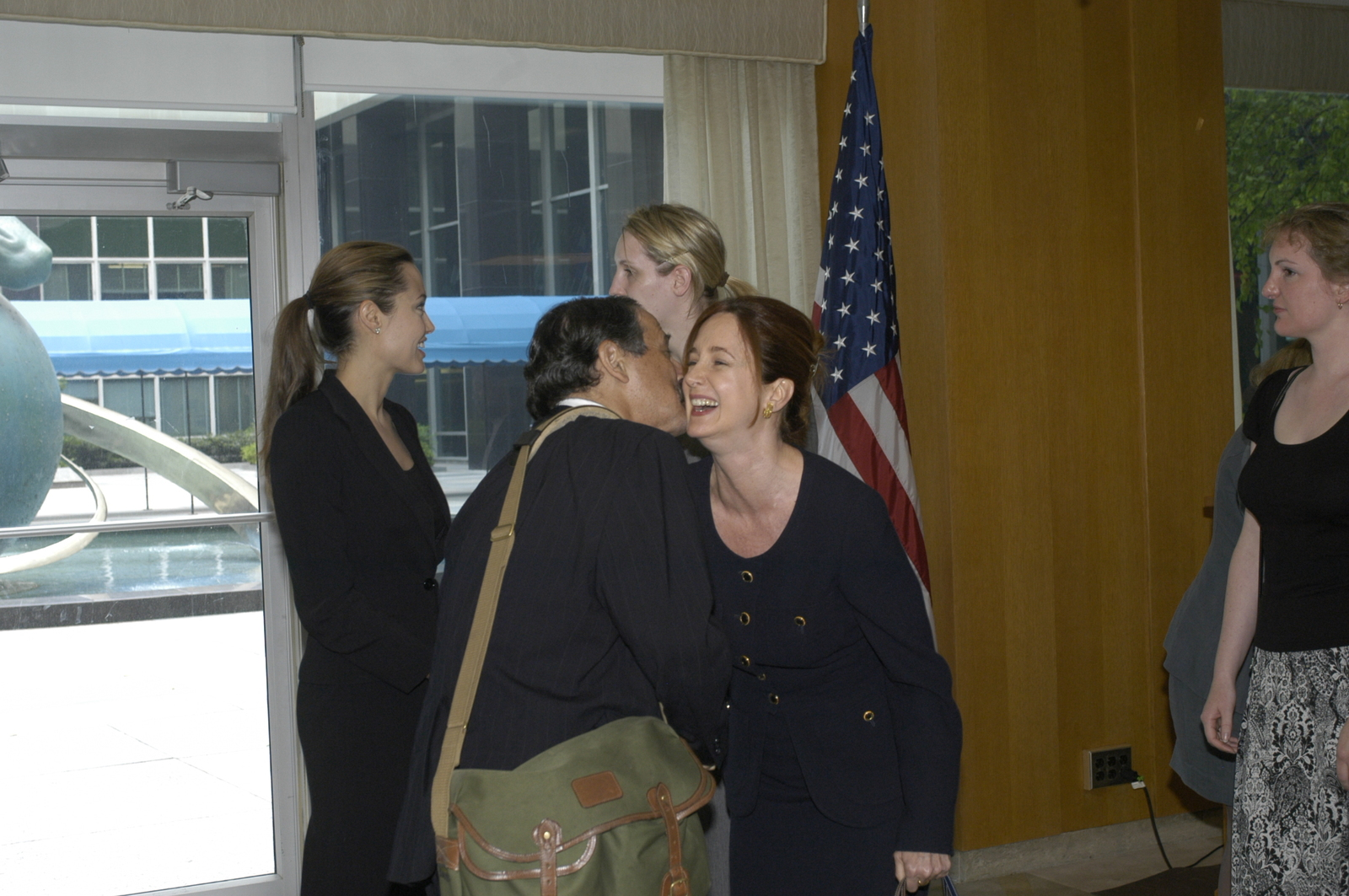 "[Assignment: 59-CF-DS-11872A-04] Reception at Harry S. Truman Building for actress Angelina Jolie, greeted by Department officials and staff [including Secretary Colin Powell, Under Secretary for Global Affairs Paula Dobriansky, and Secretary's Open Forum Chairman William Keppler. Jolie participated in Open Forum panel discussion of the documentary film that she narrated, ""Trading Women,"" an investigation of Southeast Asian sex trafficking.] [Photographer: Ann Thomas--State] [59-CF-DS-11872A-04_DSC_0027.JPG]"