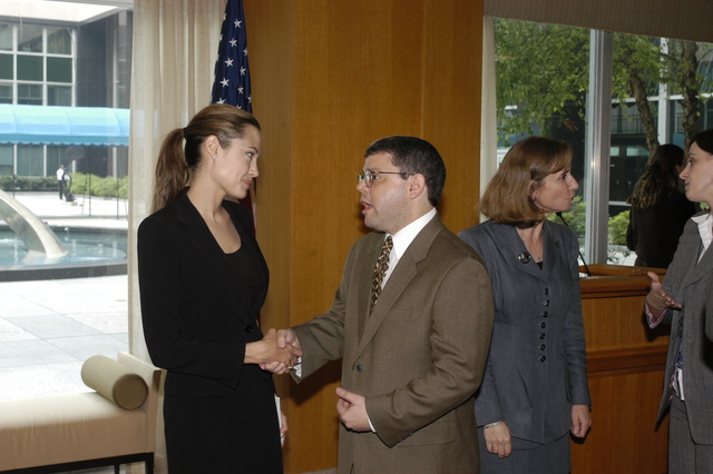 "[Assignment: 59-CF-DS-11872A-04] Reception at Harry S. Truman Building for actress Angelina Jolie, greeted by Department officials and staff [including Secretary Colin Powell, Under Secretary for Global Affairs Paula Dobriansky, and Secretary's Open Forum Chairman William Keppler. Jolie participated in Open Forum panel discussion of the documentary film that she narrated, ""Trading Women,"" an investigation of Southeast Asian sex trafficking.] [Photographer: Ann Thomas--State] [59-CF-DS-11872A-04_O_F_5_25_04_116.jpg]"