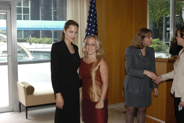 "[Assignment: 59-CF-DS-11872A-04] Reception at Harry S. Truman Building for actress Angelina Jolie, greeted by Department officials and staff [including Secretary Colin Powell, Under Secretary for Global Affairs Paula Dobriansky, and Secretary's Open Forum Chairman William Keppler. Jolie participated in Open Forum panel discussion of the documentary film that she narrated, ""Trading Women,"" an investigation of Southeast Asian sex trafficking.] [Photographer: Ann Thomas--State] [59-CF-DS-11872A-04_O_F_5_25_04_098.jpg]"