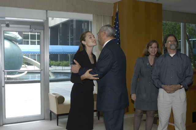 "[Assignment: 59-CF-DS-11872A-04] Reception at Harry S. Truman Building for actress Angelina Jolie, greeted by Department officials and staff [including Secretary Colin Powell, Under Secretary for Global Affairs Paula Dobriansky, and Secretary's Open Forum Chairman William Keppler. Jolie participated in Open Forum panel discussion of the documentary film that she narrated, ""Trading Women,"" an investigation of Southeast Asian sex trafficking.] [Photographer: Ann Thomas--State] [59-CF-DS-11872A-04_DSC_0016.JPG]"