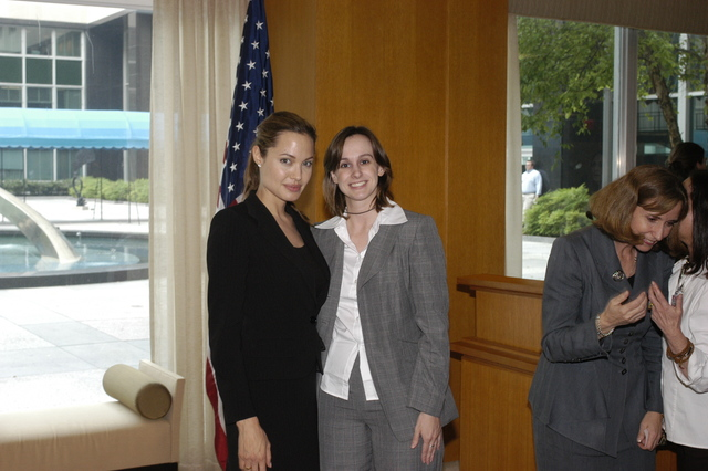 "[Assignment: 59-CF-DS-11872A-04] Reception at Harry S. Truman Building for actress Angelina Jolie, greeted by Department officials and staff [including Secretary Colin Powell, Under Secretary for Global Affairs Paula Dobriansky, and Secretary's Open Forum Chairman William Keppler. Jolie participated in Open Forum panel discussion of the documentary film that she narrated, ""Trading Women,"" an investigation of Southeast Asian sex trafficking.] [Photographer: Ann Thomas--State] [59-CF-DS-11872A-04_O_F_5_25_04_119.jpg]"