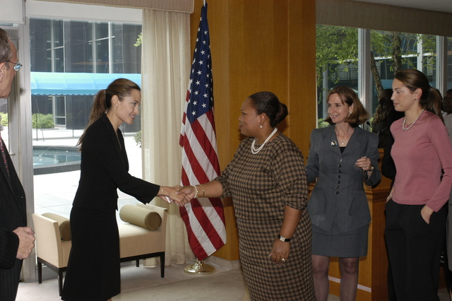 "[Assignment: 59-CF-DS-11872A-04] Reception at Harry S. Truman Building for actress Angelina Jolie, greeted by Department officials and staff [including Secretary Colin Powell, Under Secretary for Global Affairs Paula Dobriansky, and Secretary's Open Forum Chairman William Keppler. Jolie participated in Open Forum panel discussion of the documentary film that she narrated, ""Trading Women,"" an investigation of Southeast Asian sex trafficking.] [Photographer: Ann Thomas--State] [59-CF-DS-11872A-04_O_F_5_25_04_093.jpg]"