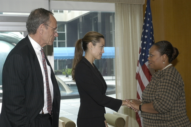 "[Assignment: 59-CF-DS-11872A-04] Reception at Harry S. Truman Building for actress Angelina Jolie, greeted by Department officials and staff [including Secretary Colin Powell, Under Secretary for Global Affairs Paula Dobriansky, and Secretary's Open Forum Chairman William Keppler. Jolie participated in Open Forum panel discussion of the documentary film that she narrated, ""Trading Women,"" an investigation of Southeast Asian sex trafficking.] [Photographer: Ann Thomas--State] [59-CF-DS-11872A-04_DSC_0063.JPG]"
