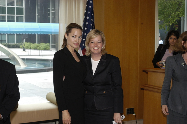 "[Assignment: 59-CF-DS-11872A-04] Reception at Harry S. Truman Building for actress Angelina Jolie, greeted by Department officials and staff [including Secretary Colin Powell, Under Secretary for Global Affairs Paula Dobriansky, and Secretary's Open Forum Chairman William Keppler. Jolie participated in Open Forum panel discussion of the documentary film that she narrated, ""Trading Women,"" an investigation of Southeast Asian sex trafficking.] [Photographer: Ann Thomas--State] [59-CF-DS-11872A-04_O_F_5_25_04_109.jpg]"