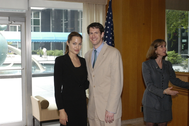 "[Assignment: 59-CF-DS-11872A-04] Reception at Harry S. Truman Building for actress Angelina Jolie, greeted by Department officials and staff [including Secretary Colin Powell, Under Secretary for Global Affairs Paula Dobriansky, and Secretary's Open Forum Chairman William Keppler. Jolie participated in Open Forum panel discussion of the documentary film that she narrated, ""Trading Women,"" an investigation of Southeast Asian sex trafficking.] [Photographer: Ann Thomas--State] [59-CF-DS-11872A-04_O_F_5_25_04_100.jpg]"