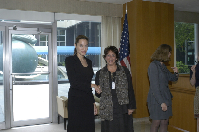 "[Assignment: 59-CF-DS-11872A-04] Reception at Harry S. Truman Building for actress Angelina Jolie, greeted by Department officials and staff [including Secretary Colin Powell, Under Secretary for Global Affairs Paula Dobriansky, and Secretary's Open Forum Chairman William Keppler. Jolie participated in Open Forum panel discussion of the documentary film that she narrated, ""Trading Women,"" an investigation of Southeast Asian sex trafficking.] [Photographer: Ann Thomas--State] [59-CF-DS-11872A-04_DSC_0006.JPG]"
