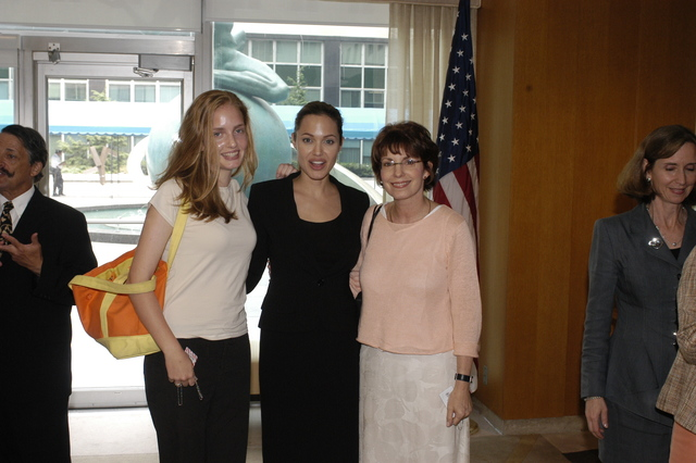 "[Assignment: 59-CF-DS-11872A-04] Reception at Harry S. Truman Building for actress Angelina Jolie, greeted by Department officials and staff [including Secretary Colin Powell, Under Secretary for Global Affairs Paula Dobriansky, and Secretary's Open Forum Chairman William Keppler. Jolie participated in Open Forum panel discussion of the documentary film that she narrated, ""Trading Women,"" an investigation of Southeast Asian sex trafficking.] [Photographer: Ann Thomas--State] [59-CF-DS-11872A-04_O_F_5_25_04_113.jpg]"