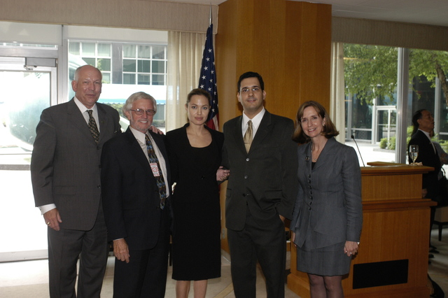 "[Assignment: 59-CF-DS-11872A-04] Reception at Harry S. Truman Building for actress Angelina Jolie, greeted by Department officials and staff [including Secretary Colin Powell, Under Secretary for Global Affairs Paula Dobriansky, and Secretary's Open Forum Chairman William Keppler. Jolie participated in Open Forum panel discussion of the documentary film that she narrated, ""Trading Women,"" an investigation of Southeast Asian sex trafficking.] [Photographer: Ann Thomas--State] [59-CF-DS-11872A-04_O_F_5_25_04_139.jpg]"