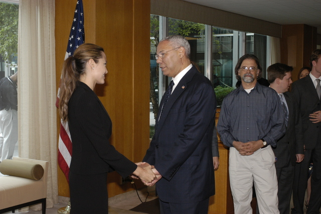 "[Assignment: 59-CF-DS-11872A-04] Reception at Harry S. Truman Building for actress Angelina Jolie, greeted by Department officials and staff [including Secretary Colin Powell, Under Secretary for Global Affairs Paula Dobriansky, and Secretary's Open Forum Chairman William Keppler. Jolie participated in Open Forum panel discussion of the documentary film that she narrated, ""Trading Women,"" an investigation of Southeast Asian sex trafficking.] [Photographer: Ann Thomas--State] [59-CF-DS-11872A-04_O_F_5_25_04_089.jpg]"