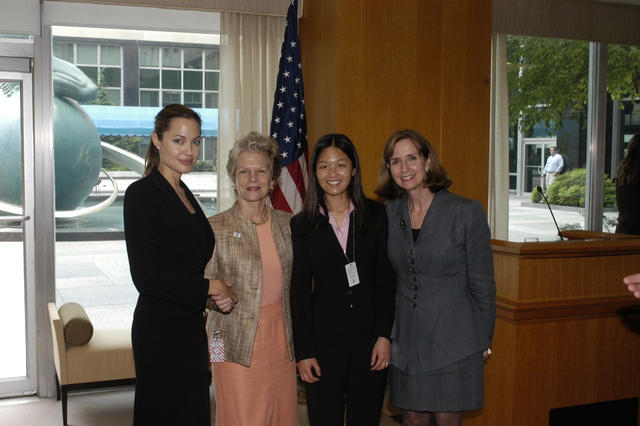 "[Assignment: 59-CF-DS-11872A-04] Reception at Harry S. Truman Building for actress Angelina Jolie, greeted by Department officials and staff [including Secretary Colin Powell, Under Secretary for Global Affairs Paula Dobriansky, and Secretary's Open Forum Chairman William Keppler. Jolie participated in Open Forum panel discussion of the documentary film that she narrated, ""Trading Women,"" an investigation of Southeast Asian sex trafficking.] [Photographer: Ann Thomas--State] [59-CF-DS-11872A-04_O_F_5_25_04_115.jpg]"