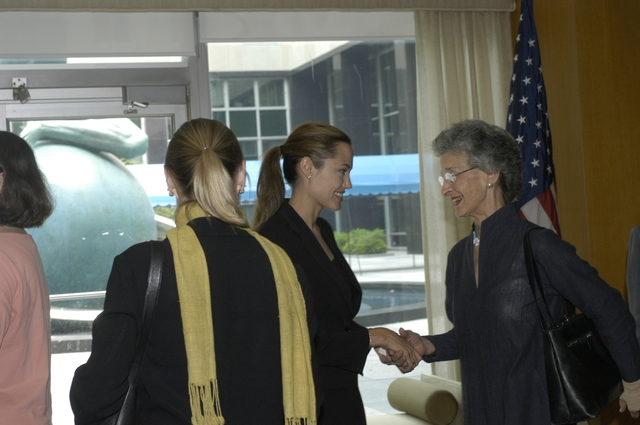 "[Assignment: 59-CF-DS-11872A-04] Reception at Harry S. Truman Building for actress Angelina Jolie, greeted by Department officials and staff [including Secretary Colin Powell, Under Secretary for Global Affairs Paula Dobriansky, and Secretary's Open Forum Chairman William Keppler. Jolie participated in Open Forum panel discussion of the documentary film that she narrated, ""Trading Women,"" an investigation of Southeast Asian sex trafficking.] [Photographer: Ann Thomas--State] [59-CF-DS-11872A-04_DSC_0056.JPG]"