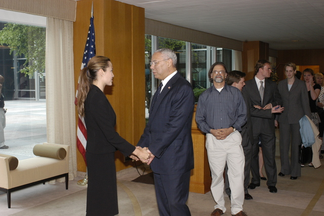 "[Assignment: 59-CF-DS-11872A-04] Reception at Harry S. Truman Building for actress Angelina Jolie, greeted by Department officials and staff [including Secretary Colin Powell, Under Secretary for Global Affairs Paula Dobriansky, and Secretary's Open Forum Chairman William Keppler. Jolie participated in Open Forum panel discussion of the documentary film that she narrated, ""Trading Women,"" an investigation of Southeast Asian sex trafficking.] [Photographer: Ann Thomas--State] [59-CF-DS-11872A-04_O_F_5_25_04_088.jpg]"