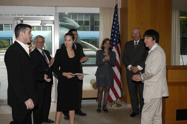 "[Assignment: 59-CF-DS-11872A-04] Reception at Harry S. Truman Building for actress Angelina Jolie, greeted by Department officials and staff [including Secretary Colin Powell, Under Secretary for Global Affairs Paula Dobriansky, and Secretary's Open Forum Chairman William Keppler. Jolie participated in Open Forum panel discussion of the documentary film that she narrated, ""Trading Women,"" an investigation of Southeast Asian sex trafficking.] [Photographer: Ann Thomas--State] [59-CF-DS-11872A-04_O_F_5_25_04_143.jpg]"
