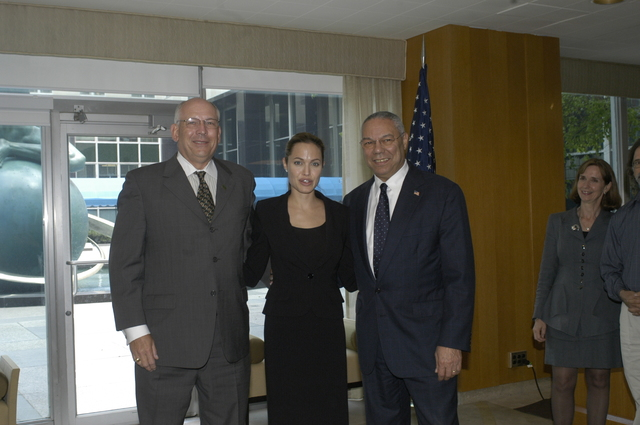 "[Assignment: 59-CF-DS-11872A-04] Reception at Harry S. Truman Building for actress Angelina Jolie, greeted by Department officials and staff [including Secretary Colin Powell, Under Secretary for Global Affairs Paula Dobriansky, and Secretary's Open Forum Chairman William Keppler. Jolie participated in Open Forum panel discussion of the documentary film that she narrated, ""Trading Women,"" an investigation of Southeast Asian sex trafficking.] [Photographer: Ann Thomas--State] [59-CF-DS-11872A-04_DSC_0021.JPG]"