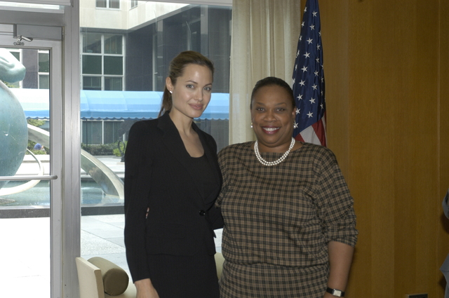 "[Assignment: 59-CF-DS-11872A-04] Reception at Harry S. Truman Building for actress Angelina Jolie, greeted by Department officials and staff [including Secretary Colin Powell, Under Secretary for Global Affairs Paula Dobriansky, and Secretary's Open Forum Chairman William Keppler. Jolie participated in Open Forum panel discussion of the documentary film that she narrated, ""Trading Women,"" an investigation of Southeast Asian sex trafficking.] [Photographer: Ann Thomas--State] [59-CF-DS-11872A-04_DSC_0065.JPG]"