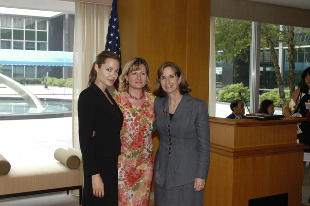 "[Assignment: 59-CF-DS-11872A-04] Reception at Harry S. Truman Building for actress Angelina Jolie, greeted by Department officials and staff [including Secretary Colin Powell, Under Secretary for Global Affairs Paula Dobriansky, and Secretary's Open Forum Chairman William Keppler. Jolie participated in Open Forum panel discussion of the documentary film that she narrated, ""Trading Women,"" an investigation of Southeast Asian sex trafficking.] [Photographer: Ann Thomas--State] [59-CF-DS-11872A-04_O_F_5_25_04_129.jpg]"