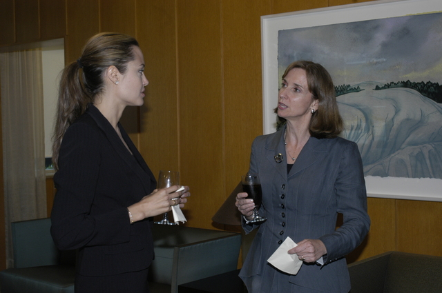 "[Assignment: 59-CF-DS-11872A-04] Reception at Harry S. Truman Building for actress Angelina Jolie, greeted by Department officials and staff [including Secretary Colin Powell, Under Secretary for Global Affairs Paula Dobriansky, and Secretary's Open Forum Chairman William Keppler. Jolie participated in Open Forum panel discussion of the documentary film that she narrated, ""Trading Women,"" an investigation of Southeast Asian sex trafficking.] [Photographer: Ann Thomas--State] [59-CF-DS-11872A-04_DSC_0003.JPG]"