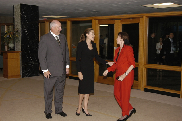 "[Assignment: 59-CF-DS-11872A-04] Reception at Harry S. Truman Building for actress Angelina Jolie, greeted by Department officials and staff [including Secretary Colin Powell, Under Secretary for Global Affairs Paula Dobriansky, and Secretary's Open Forum Chairman William Keppler. Jolie participated in Open Forum panel discussion of the documentary film that she narrated, ""Trading Women,"" an investigation of Southeast Asian sex trafficking.] [Photographer: Ann Thomas--State] [59-CF-DS-11872A-04_O_F_5_25_04_008.jpg]"