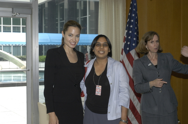 "[Assignment: 59-CF-DS-11872A-04] Reception at Harry S. Truman Building for actress Angelina Jolie, greeted by Department officials and staff [including Secretary Colin Powell, Under Secretary for Global Affairs Paula Dobriansky, and Secretary's Open Forum Chairman William Keppler. Jolie participated in Open Forum panel discussion of the documentary film that she narrated, ""Trading Women,"" an investigation of Southeast Asian sex trafficking.] [Photographer: Ann Thomas--State] [59-CF-DS-11872A-04_DSC_0053.JPG]"