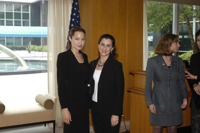 "[Assignment: 59-CF-DS-11872A-04] Reception at Harry S. Truman Building for actress Angelina Jolie, greeted by Department officials and staff [including Secretary Colin Powell, Under Secretary for Global Affairs Paula Dobriansky, and Secretary's Open Forum Chairman William Keppler. Jolie participated in Open Forum panel discussion of the documentary film that she narrated, ""Trading Women,"" an investigation of Southeast Asian sex trafficking.] [Photographer: Ann Thomas--State] [59-CF-DS-11872A-04_O_F_5_25_04_133.jpg]"