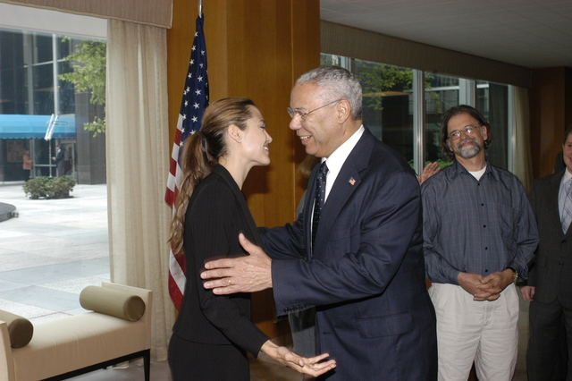 "[Assignment: 59-CF-DS-11872A-04] Reception at Harry S. Truman Building for actress Angelina Jolie, greeted by Department officials and staff [including Secretary Colin Powell, Under Secretary for Global Affairs Paula Dobriansky, and Secretary's Open Forum Chairman William Keppler. Jolie participated in Open Forum panel discussion of the documentary film that she narrated, ""Trading Women,"" an investigation of Southeast Asian sex trafficking.] [Photographer: Ann Thomas--State] [59-CF-DS-11872A-04_O_F_5_25_04_085.jpg]"