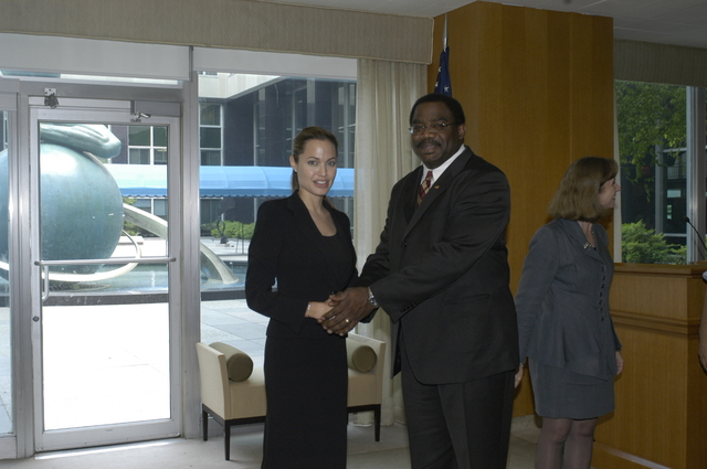 "[Assignment: 59-CF-DS-11872A-04] Reception at Harry S. Truman Building for actress Angelina Jolie, greeted by Department officials and staff [including Secretary Colin Powell, Under Secretary for Global Affairs Paula Dobriansky, and Secretary's Open Forum Chairman William Keppler. Jolie participated in Open Forum panel discussion of the documentary film that she narrated, ""Trading Women,"" an investigation of Southeast Asian sex trafficking.] [Photographer: Ann Thomas--State] [59-CF-DS-11872A-04_DSC_0010.JPG]"