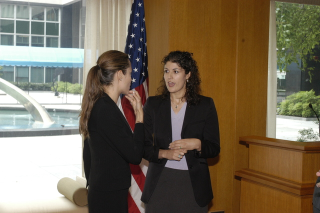 "[Assignment: 59-CF-DS-11872A-04] Reception at Harry S. Truman Building for actress Angelina Jolie, greeted by Department officials and staff [including Secretary Colin Powell, Under Secretary for Global Affairs Paula Dobriansky, and Secretary's Open Forum Chairman William Keppler. Jolie participated in Open Forum panel discussion of the documentary film that she narrated, ""Trading Women,"" an investigation of Southeast Asian sex trafficking.] [Photographer: Ann Thomas--State] [59-CF-DS-11872A-04_O_F_5_25_04_135.jpg]"